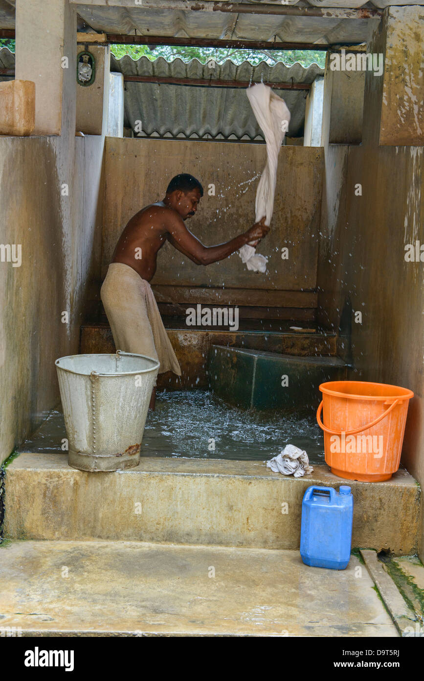 dobiwalla washing clothes at the public laundry in Fort Cochin (Kochi), Kerala, India - Stock Image