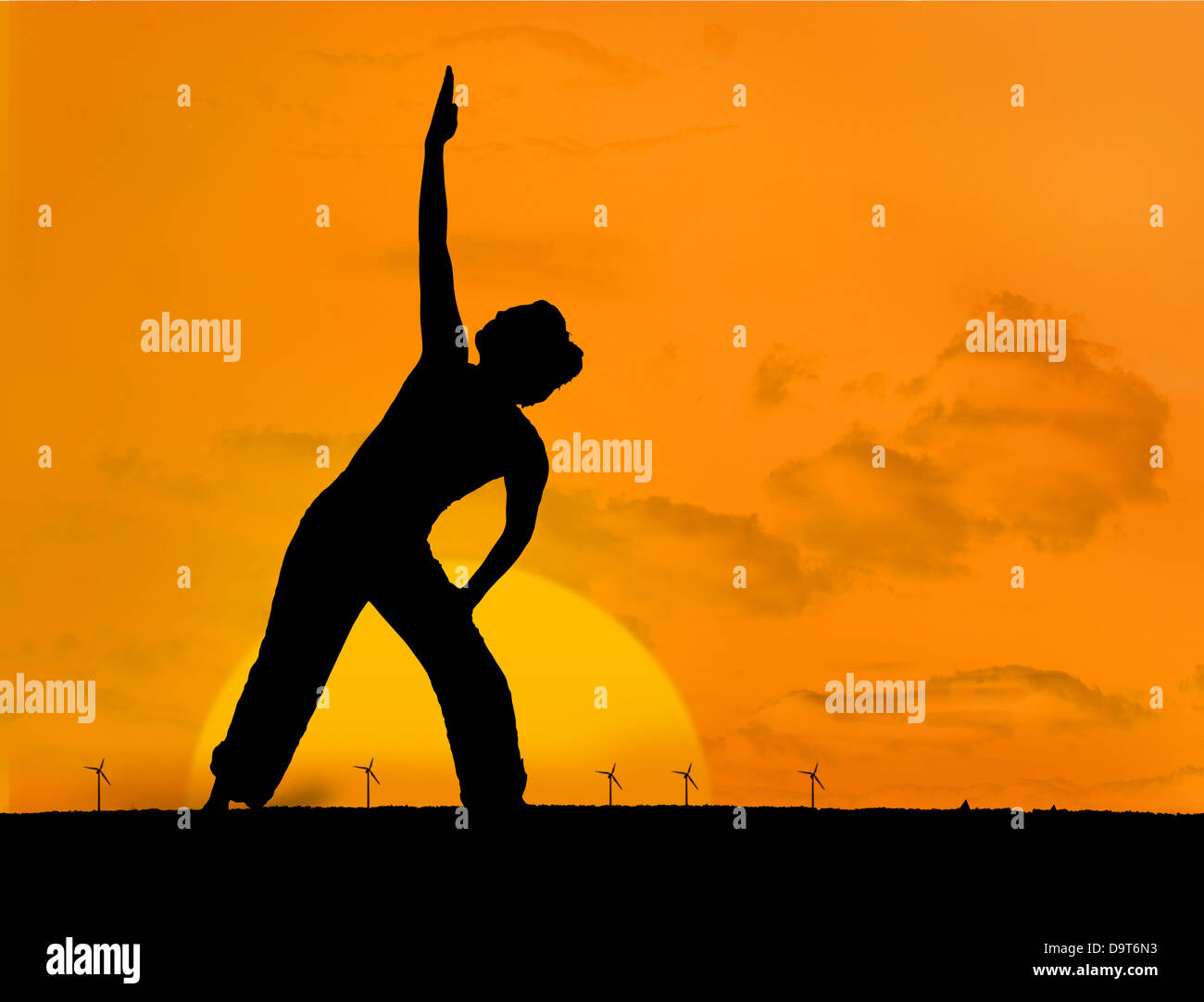 Calm silhouette of woman practicing yoga - Stock Image