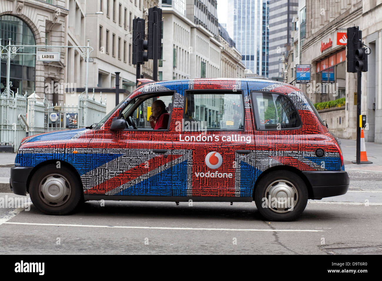 London Hackney Cab sponsored by Vodafone London England - Stock Image