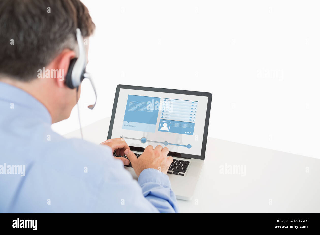 Call center worker viewing his social media profile - Stock Image