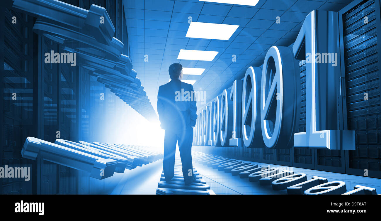 Businessman standing in data center with binary code - Stock Image