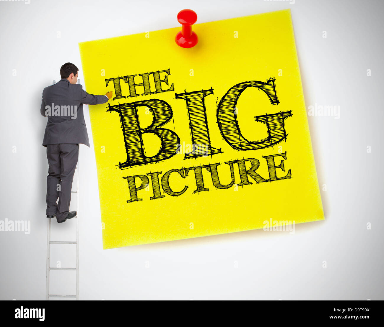 Businessman writing the big picture on a giant post it - Stock Image