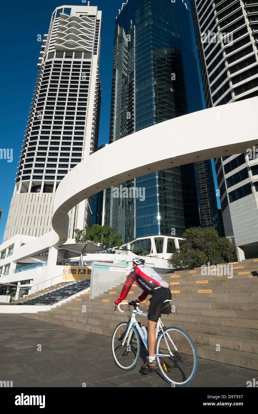 Modern high-rise buildings at Eagle Street Pier beside river in Brisbane CBD Queensland Australia - Stock Image