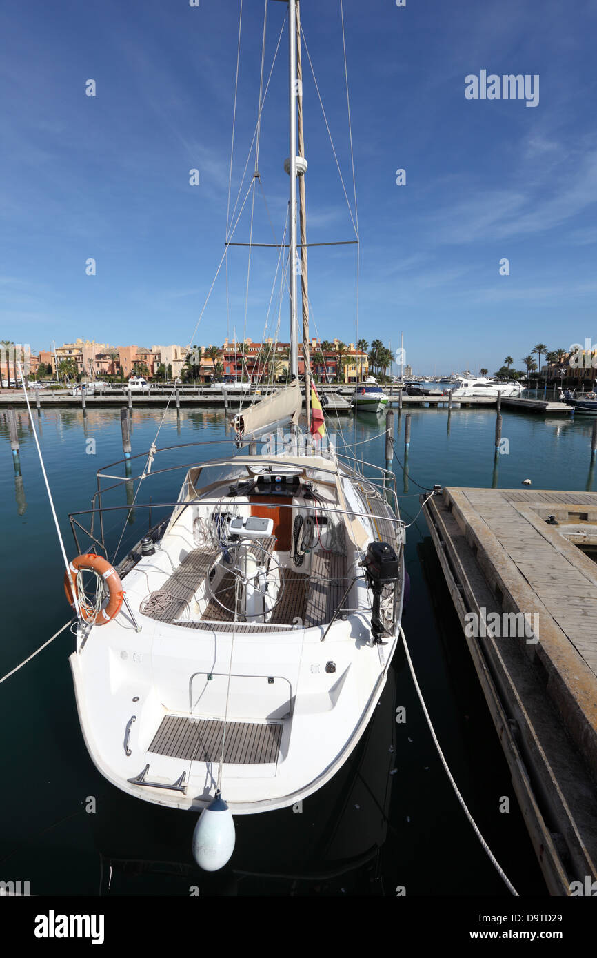 White sail yacht in the marina of Sotogrande, Andalusia Spain - Stock Image
