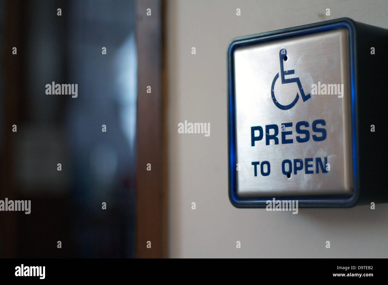Press to open disabled access automatic door panel - Stock Image