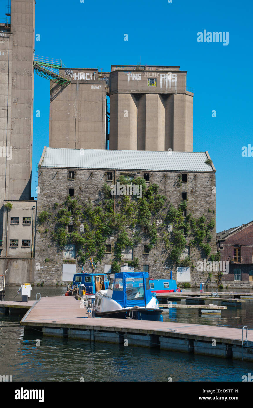 Boats in Grand Canal Docks in front of Boland's Mill in Docklands former harbour area central Dublin Ireland - Stock Image