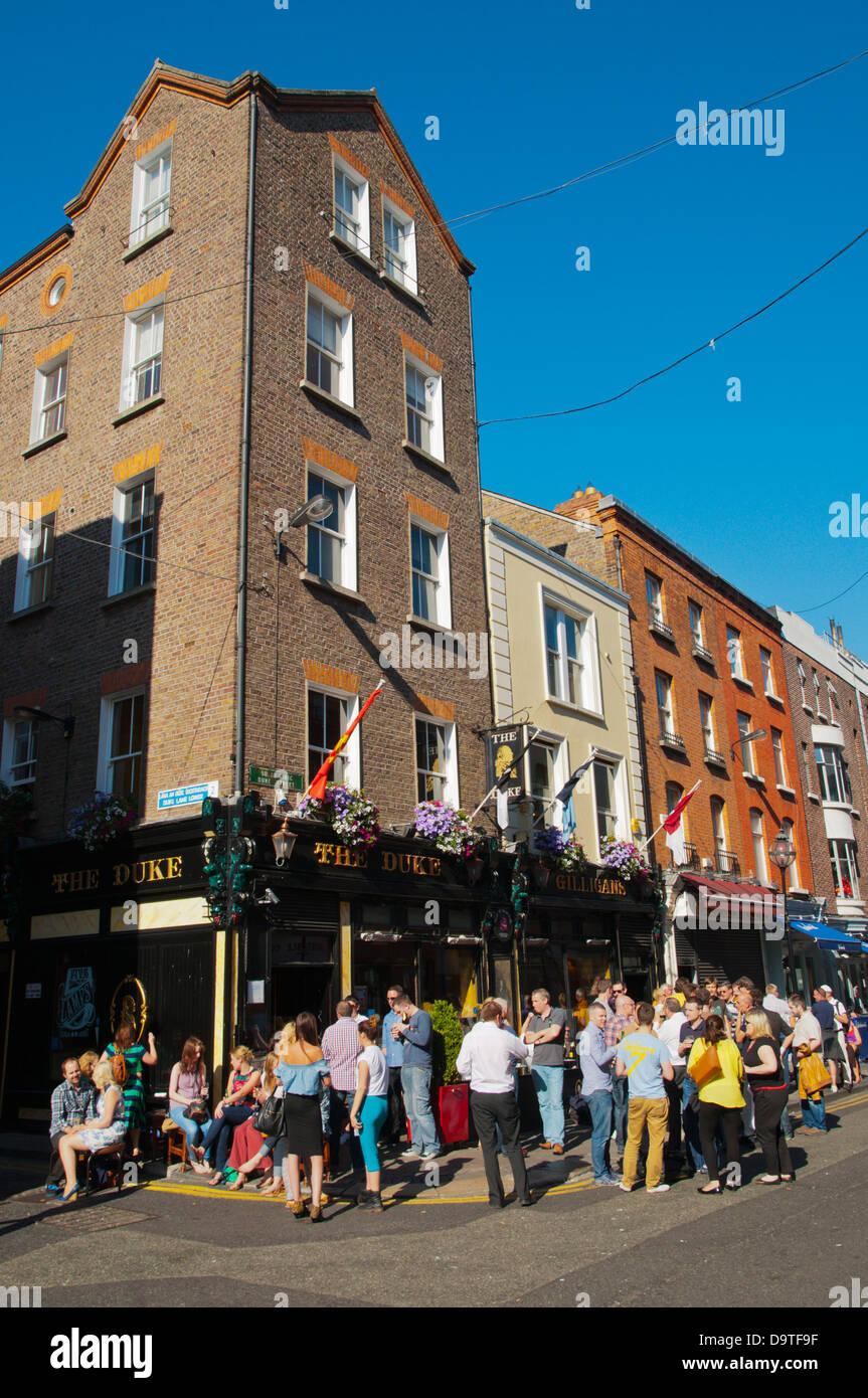 People standing outside The Duke pub Duke Street central Dublin Ireland Europe - Stock Image