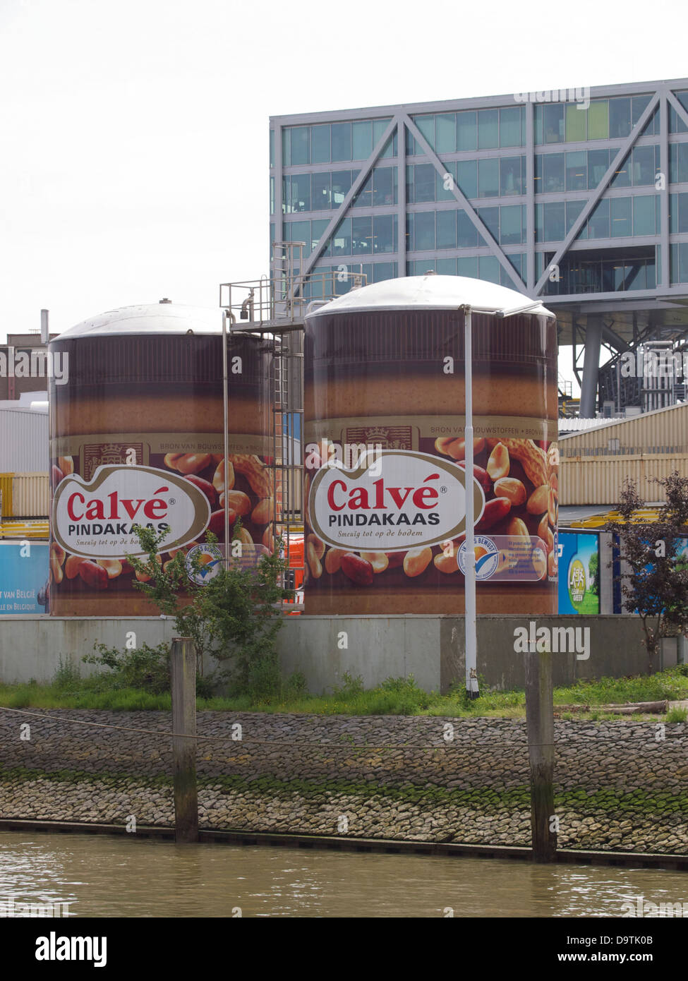two silos disguised as Calve peanut butter jars at the Unilever office in Rotterdam, the Netherlands - Stock Image