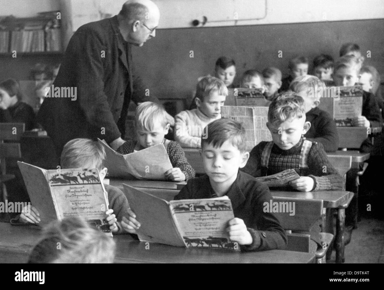 Children who were evacuated as part of the Children's Evacuation Program take part in the school lessons of - Stock Image