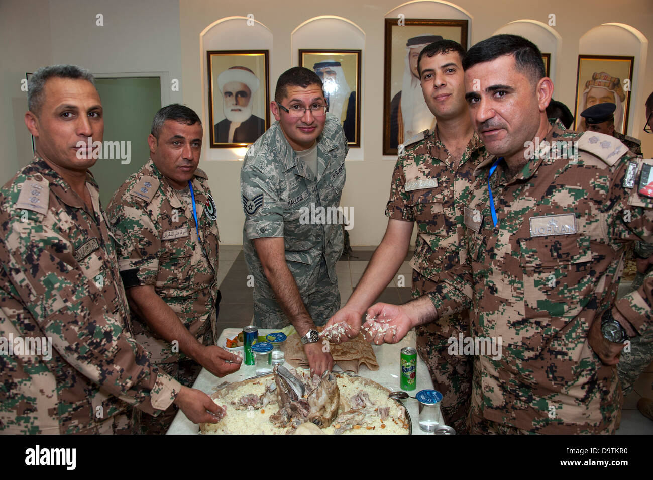 As part of the opening ceremonies of an Eager Lion event, members from the Royal Jordanian Air Force share a traditional - Stock Image