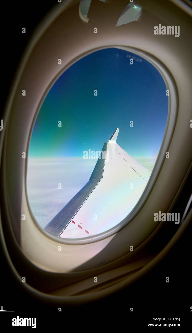 44000 >> Deep Blue Sky Behind The Wing Of A Jet Plane At 44 000 Feet High
