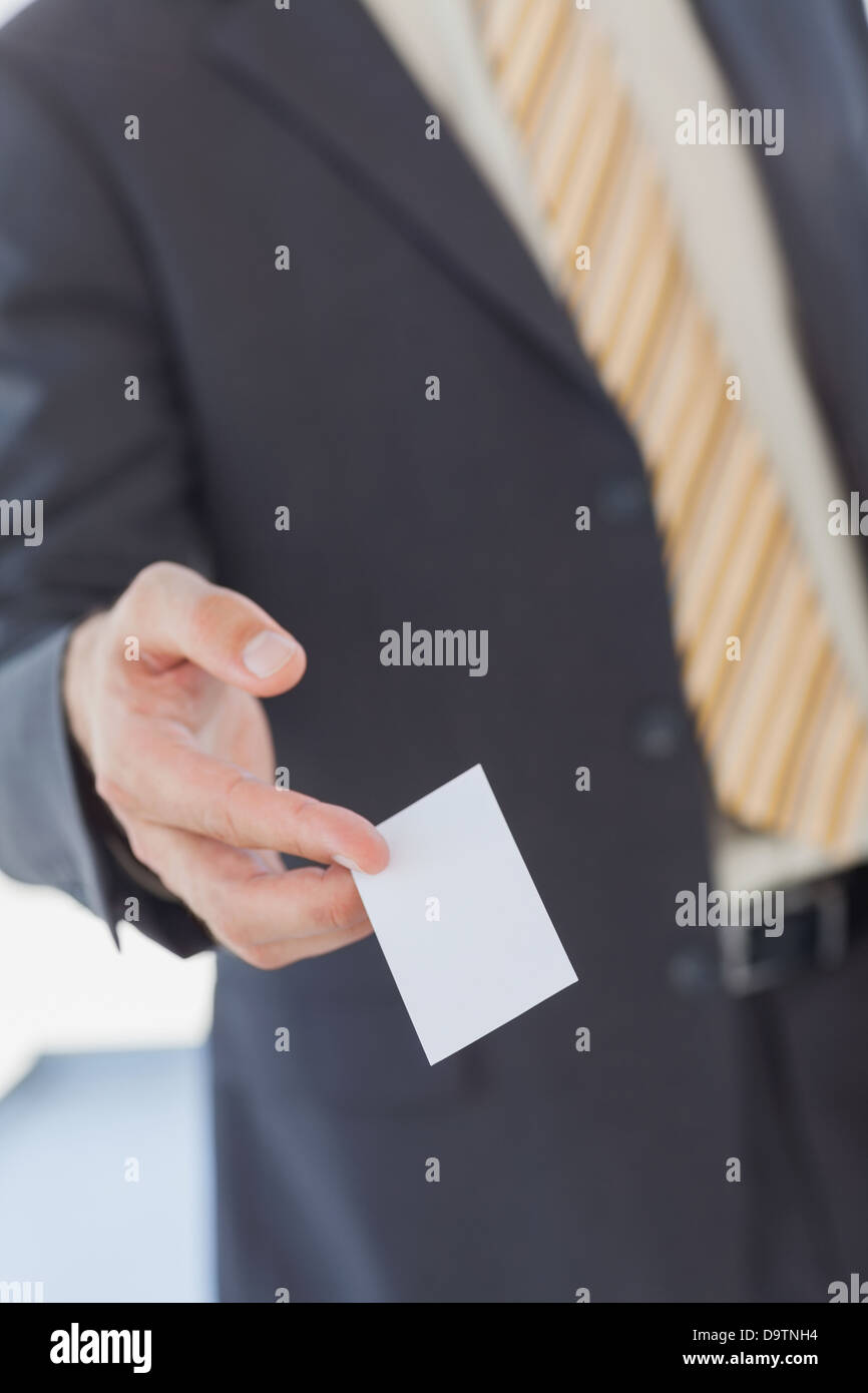 Businessman giving a white blank business card Stock Photo: 57706800 ...