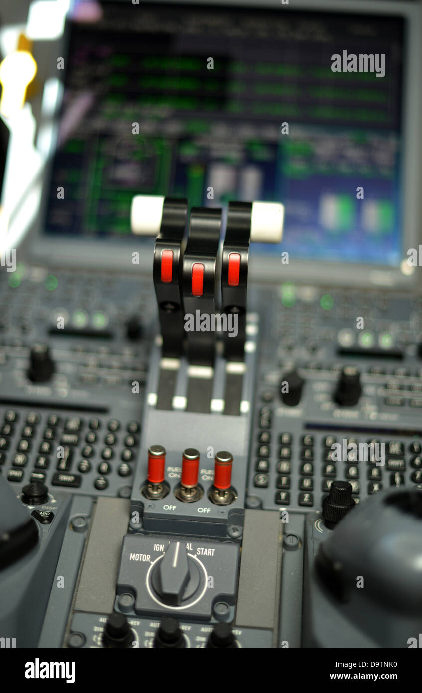 throttle levers in control panel in the cockpit of a jet plane - Stock Image