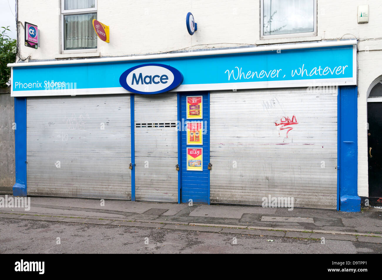 Steel roller security shutters protecting the door and windows of a UK Mace convenience store from vandalism  sc 1 st  Alamy & Steel roller security shutters protecting the door and windows of a ...
