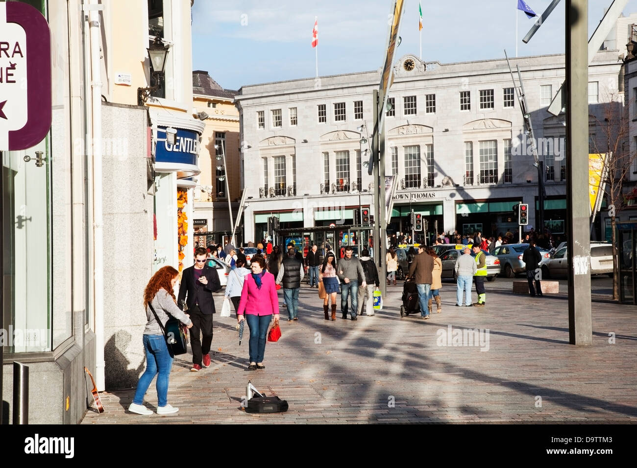 Pedestrians on patrick street;Cork city county cork ireland - Stock Image