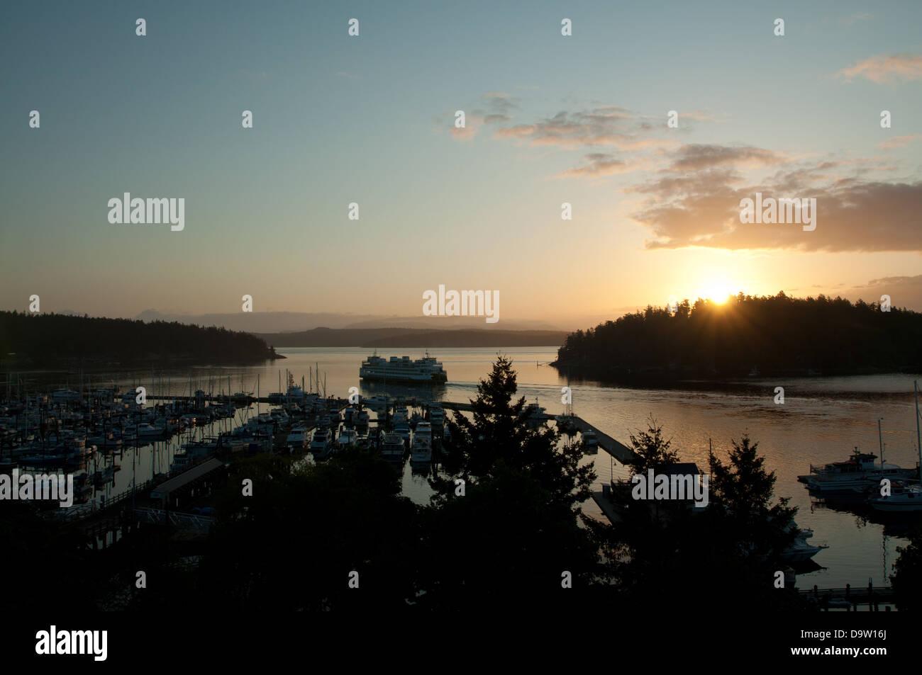 Washington State Ferry leaving Friday Harbor on San Juan Island,Washington at sunrise. - Stock Image
