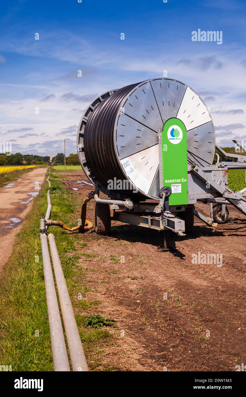 A field being irrigated due to lack of rain in the Uk - Stock Image