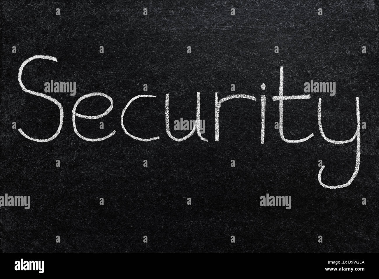 Security written with white chalk on a blackboard. - Stock Image
