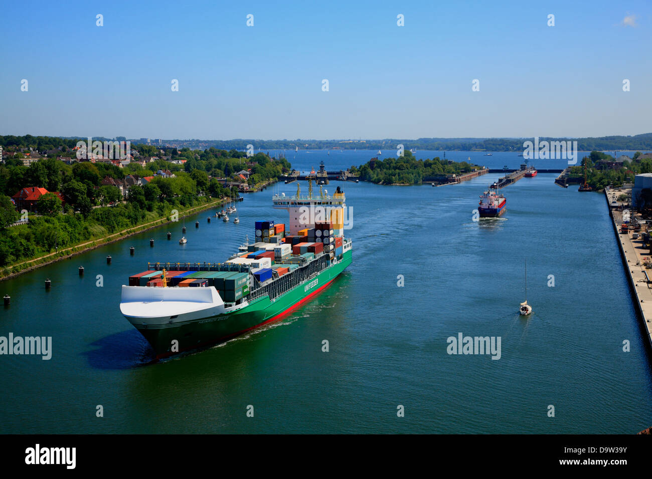Container ship on Kiel Canal at Kiel-Holtenau Lock, Kiel, Schleswig-Holstein, Germany, Europe - Stock Image