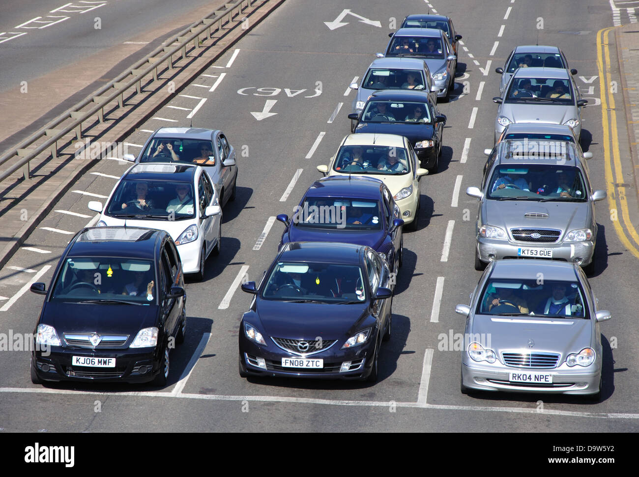 traffic queuing at road junction, Burleys Way, Leicester, England, UK - Stock Image