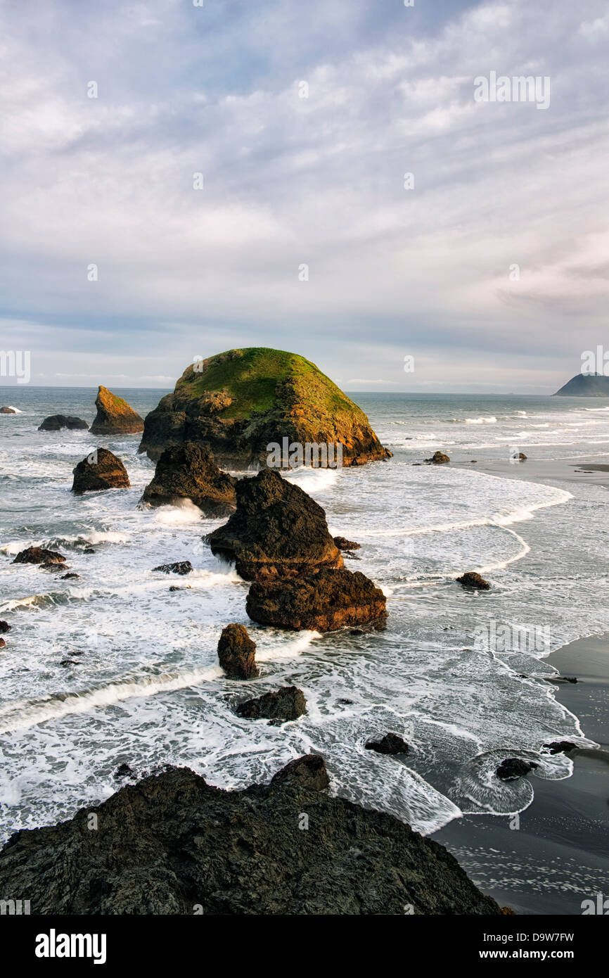 First light on the many offshore sea stacks at Crook Point on Oregon's southern coastline in Curry County. - Stock Image