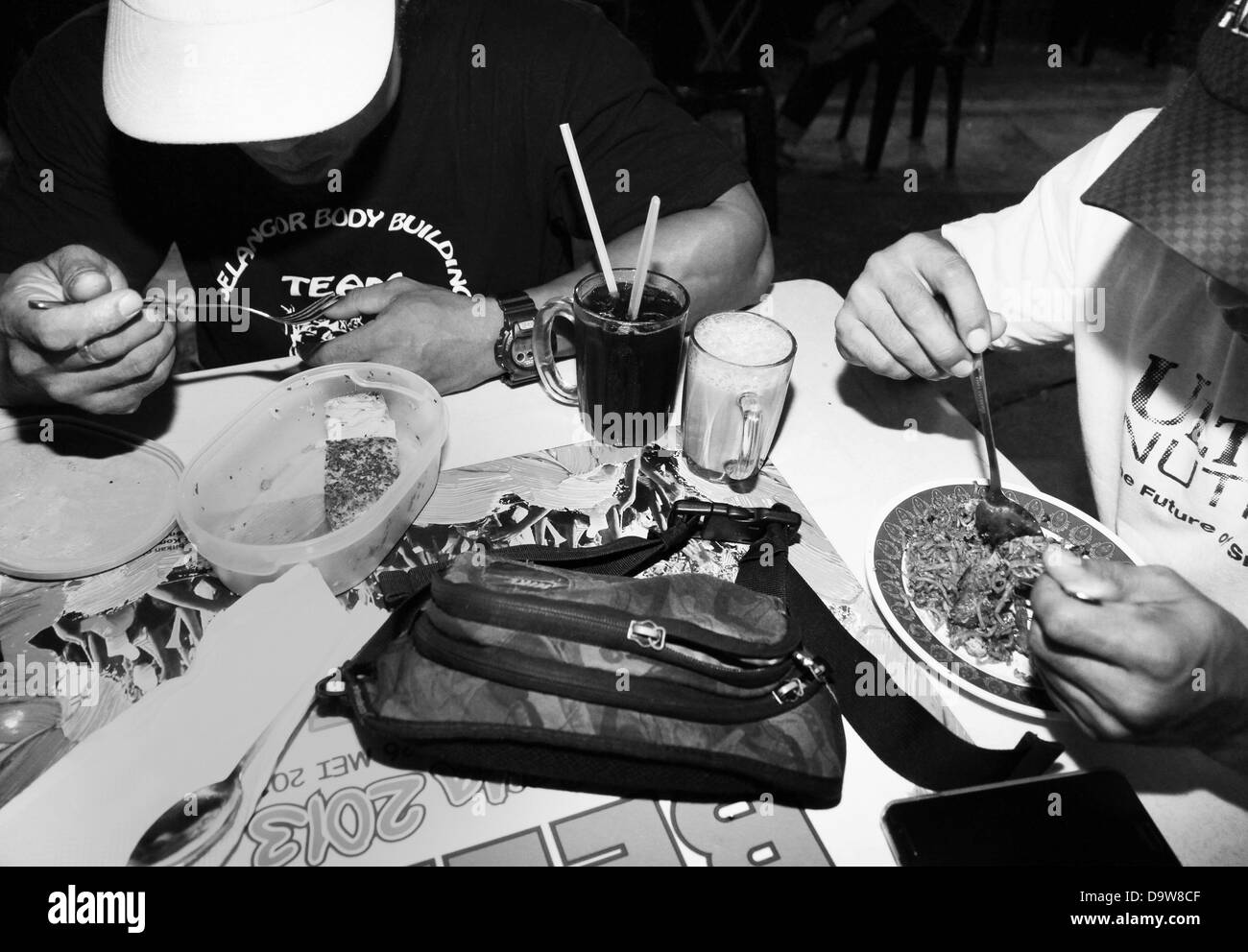 June 12, 2013 - Kuala Lumpur, KUALA LUMPUR, MALAYSIA - BAD (left) with grilled salmon prepared from home. His training - Stock Image