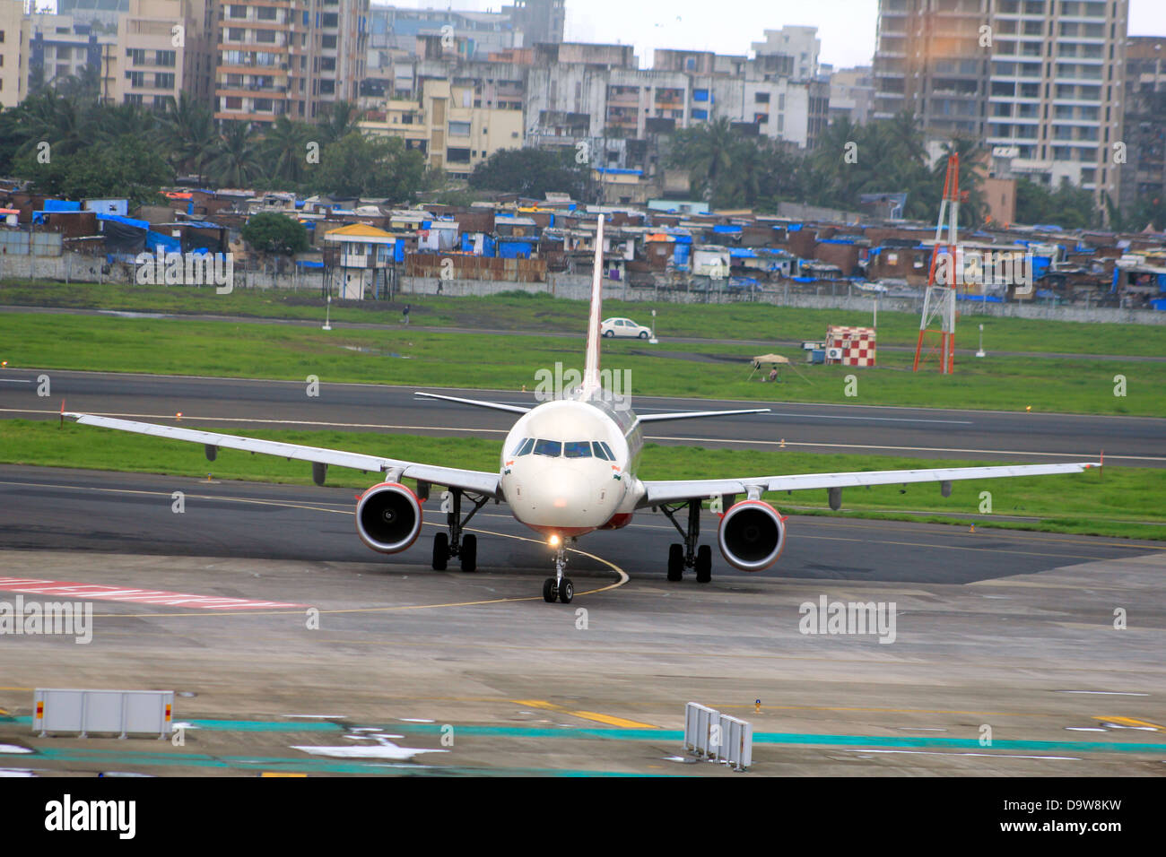 Aircraft taxiing after landing at the Chatrapati international airport ; Mumbai; India - Stock Image