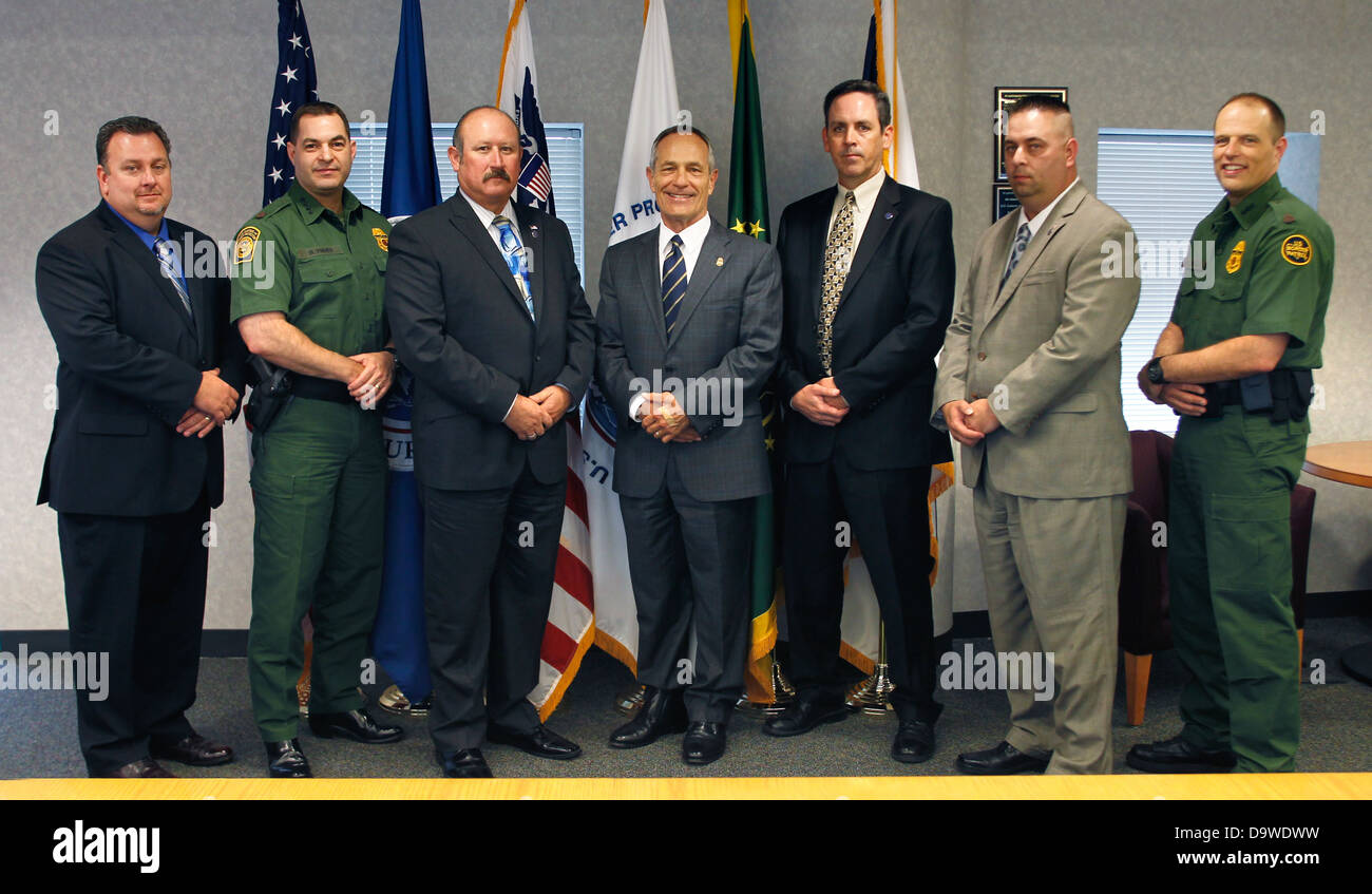 Commissioner Bersin, CBP Executives and the National Border Patrol Council (NBPC) Executives attend. - Stock Image