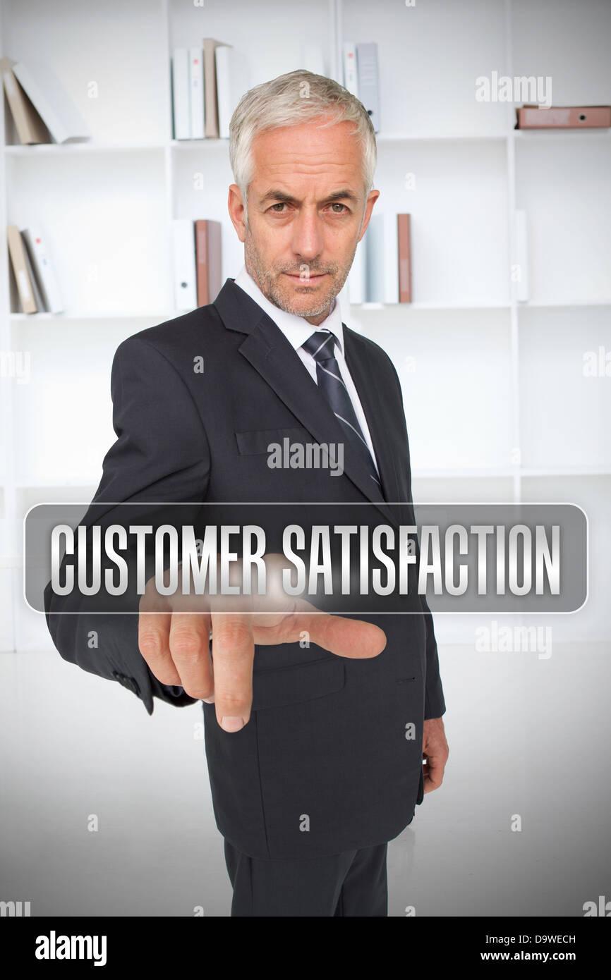 Businessman selecting the term customer satisfaction - Stock Image