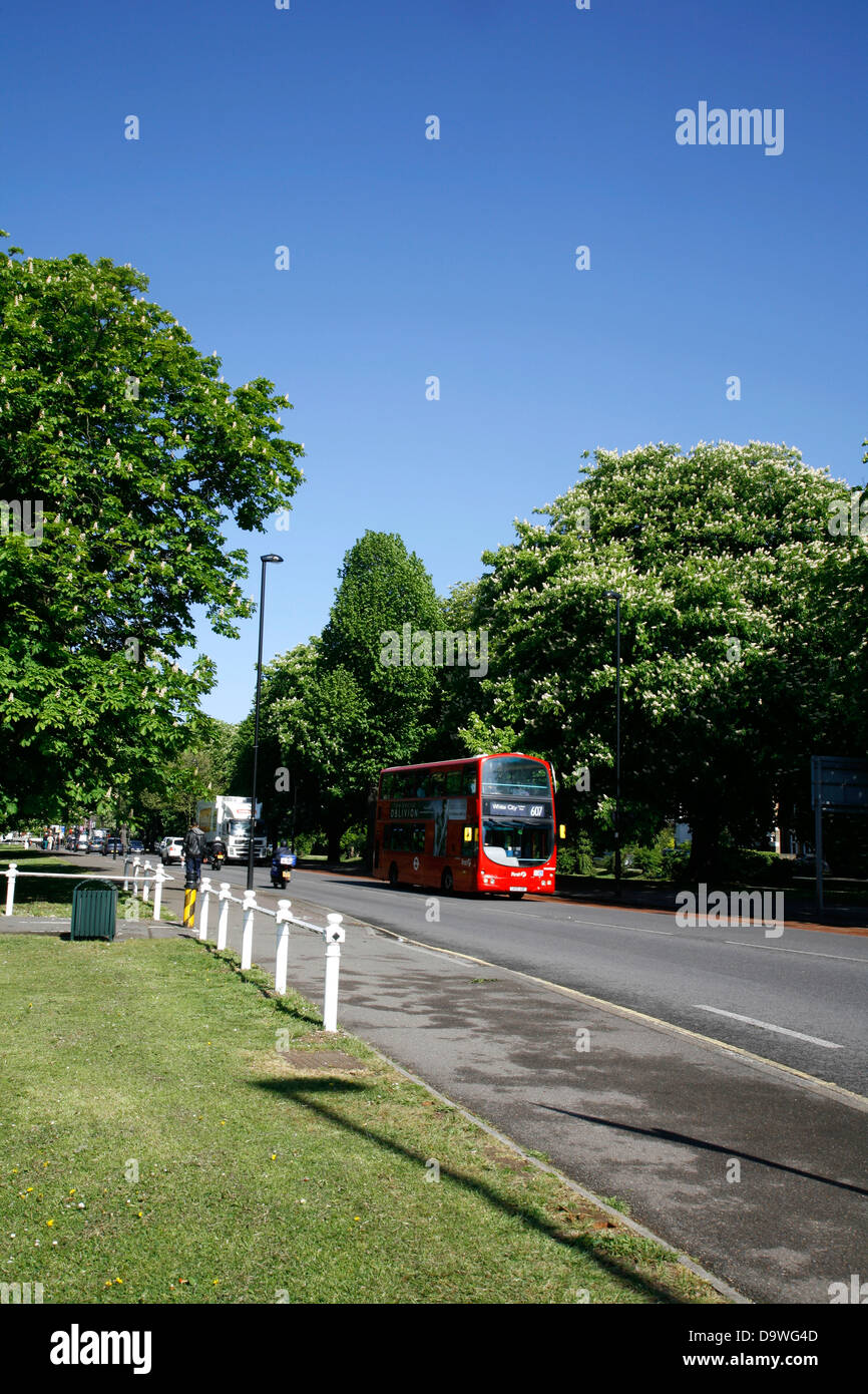 Number 607 bus crosses Ealing Common on Uxbridge Road