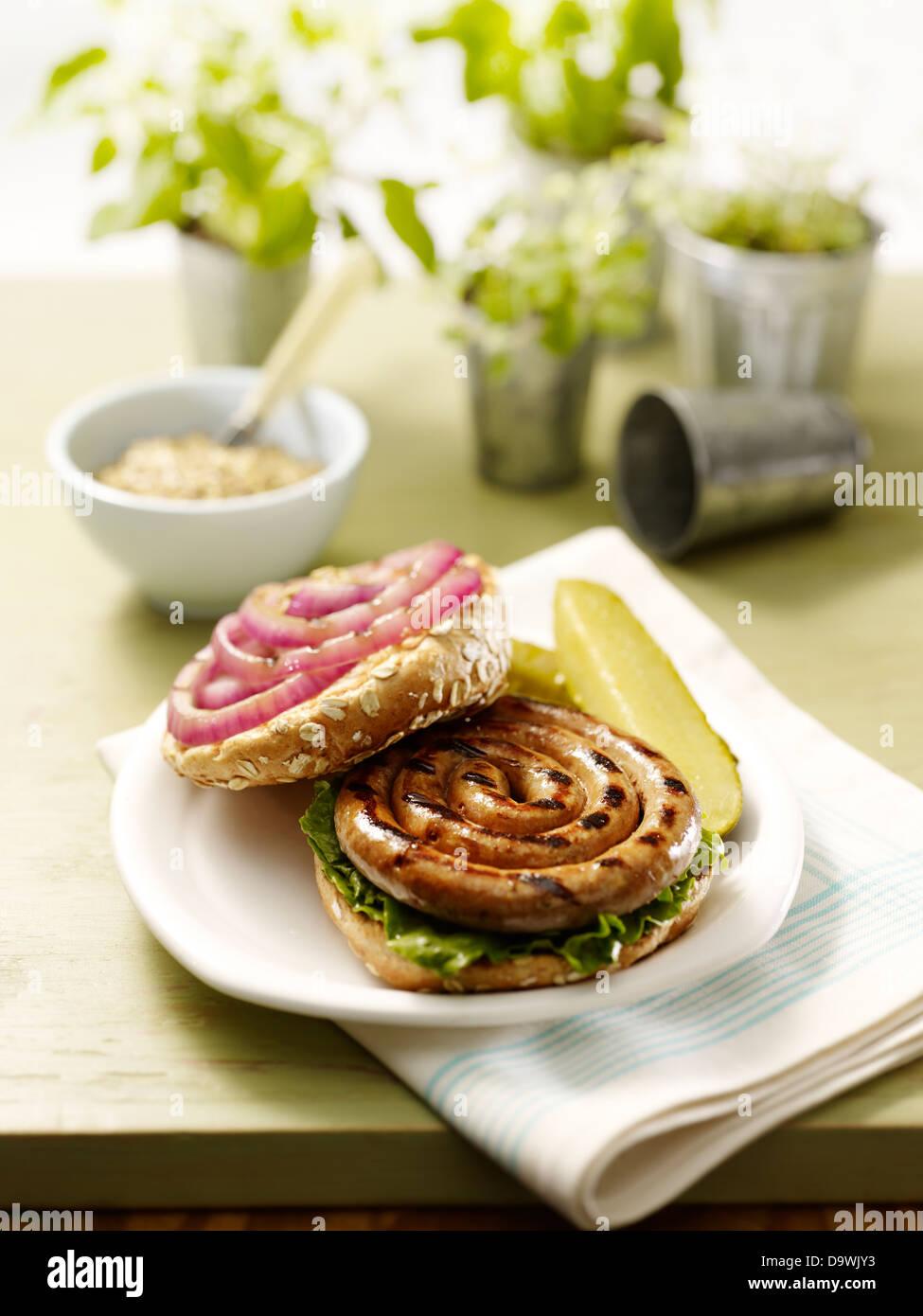 sausage spiral burger - Stock Image
