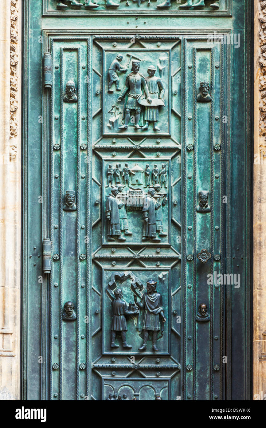 Detail of the bronze doors on the medieval gothic front facade of St Vitus Cathedral in Prague. - Stock Image