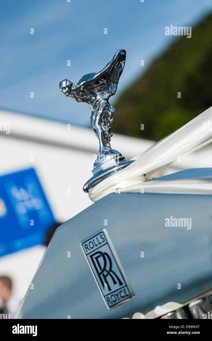 The statuette Spirit of Ecstasy on the radiator grille of a classic Rolls Royce car - Stock Image
