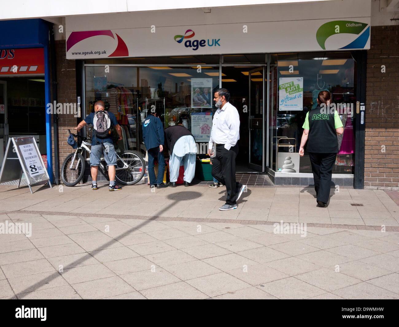 'Age UK' charity shop, Chadderton, Greater Manchester, UK. - Stock Image