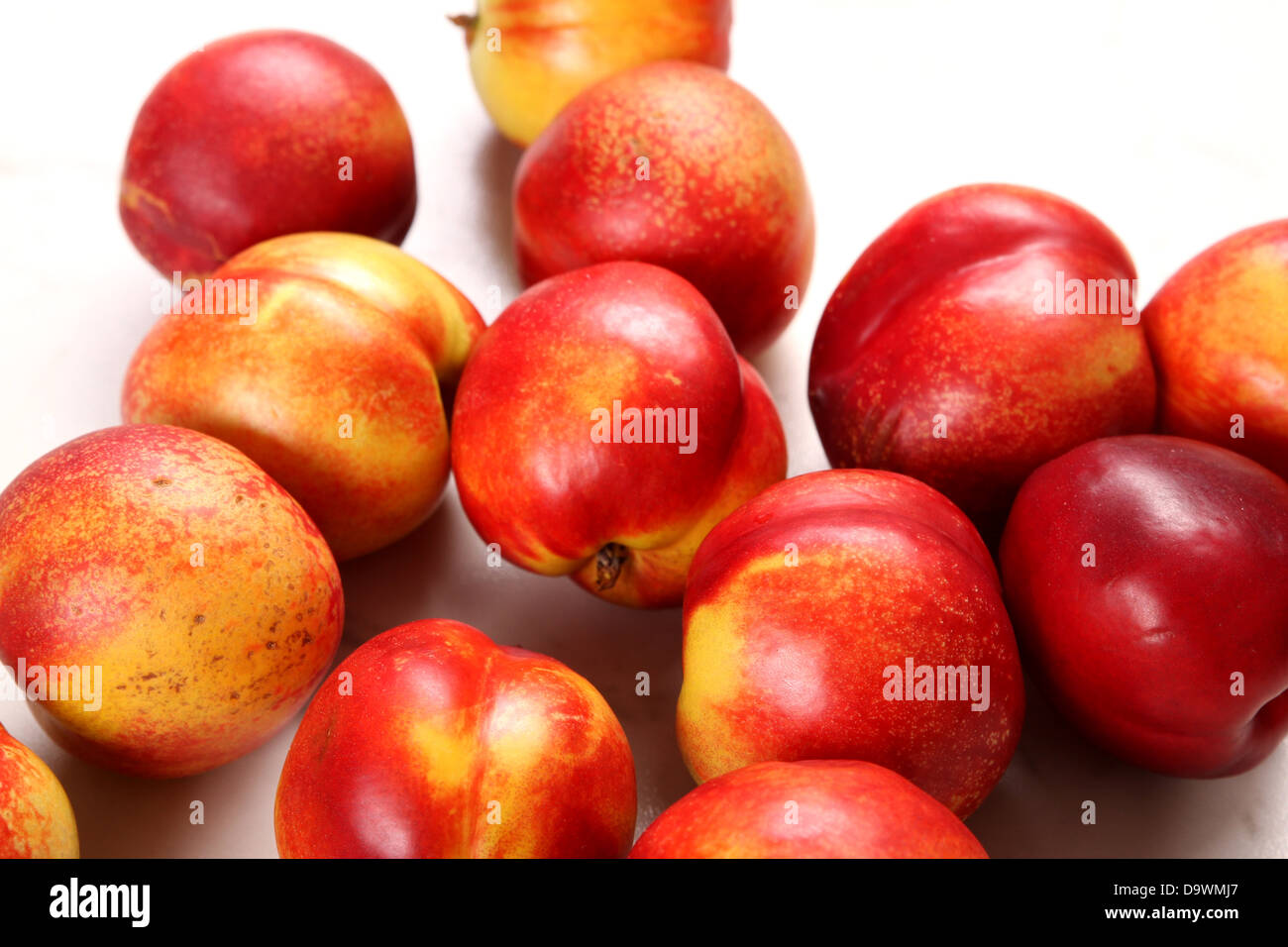 Lots of Nectarines on the kitchen table background - Stock Image