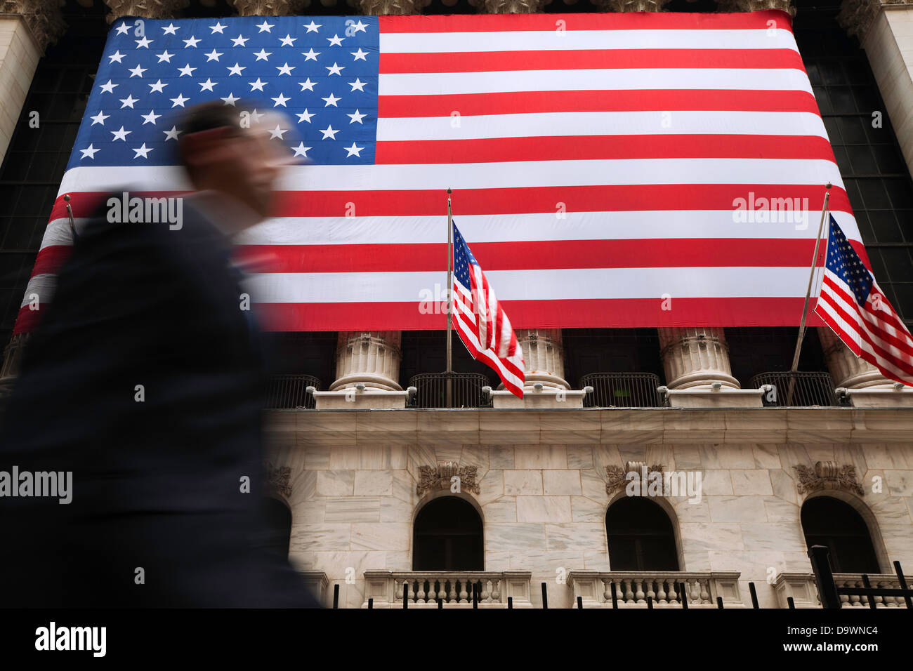 New York City, Manhattan, US flags outside the New York Stock Exchange, Wall Street - Stock Image