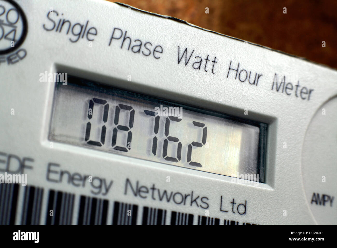 Close up of an electricity meter in a house, showing the number of watts of electricity used. - Stock Image