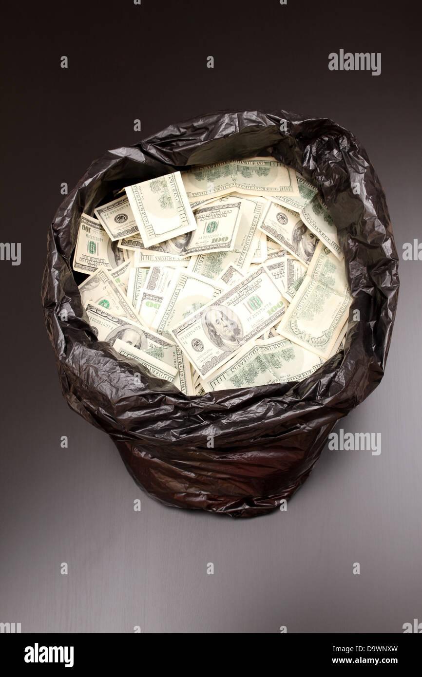 A Rubbish bag full of dollars - Stock Image