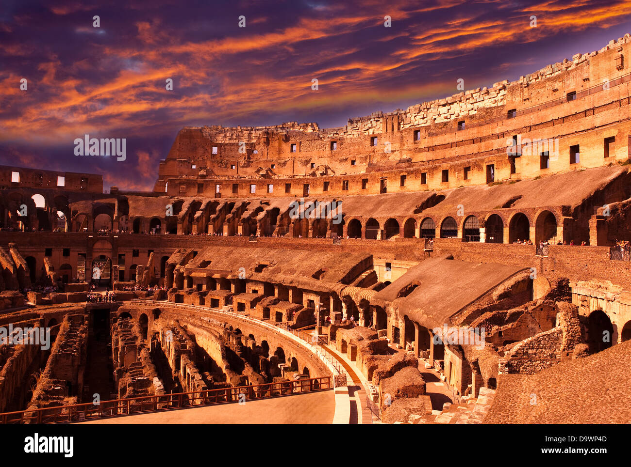 Bright crimson sunset over the ancient Colosseum. Rome. Italy - Stock Image