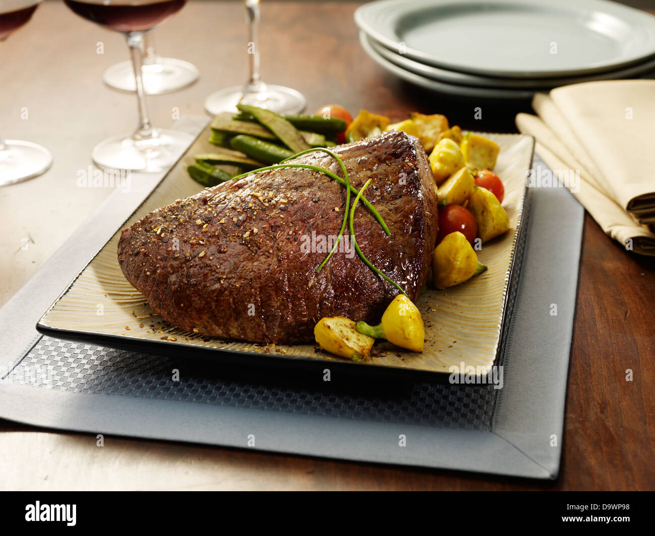 top round roast netted - Stock Image
