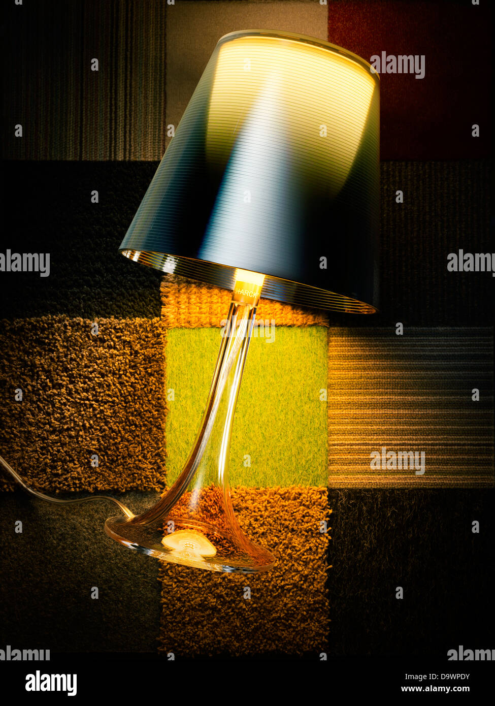 lamp on a rug - Stock Image
