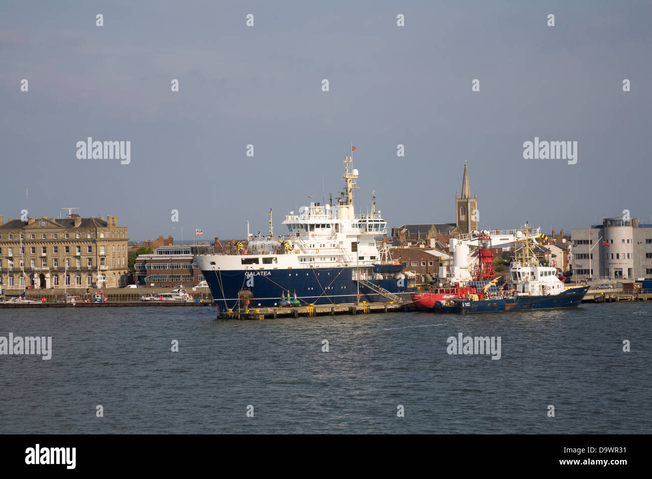 Harwich Essex South East England View of harbour front with moored THV Galatea a lighthouse tender operated by Trinity - Stock Image