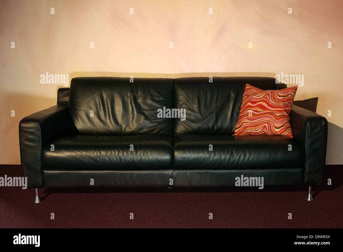 black leather couch - Stock Image