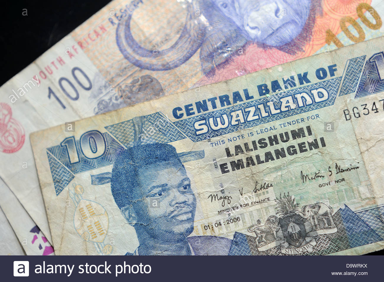 10 Swazi Emalangeni note with 100 Rand note, both currencies legal tender  in Swaziland - Stock Image