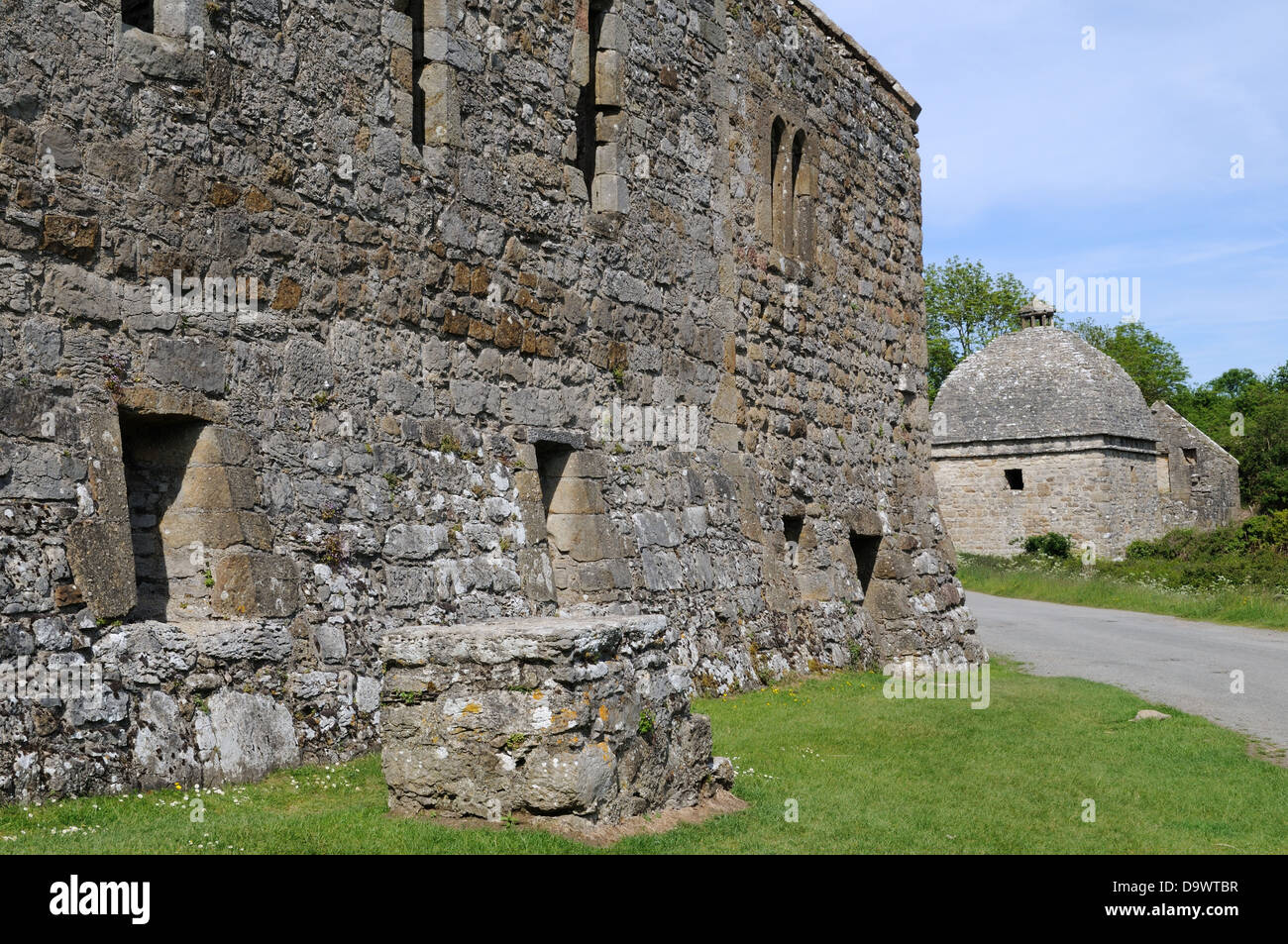 Penmon Priory and 17th C dovecot  Penmon Anglesey Wales Cymru UK GB - Stock Image