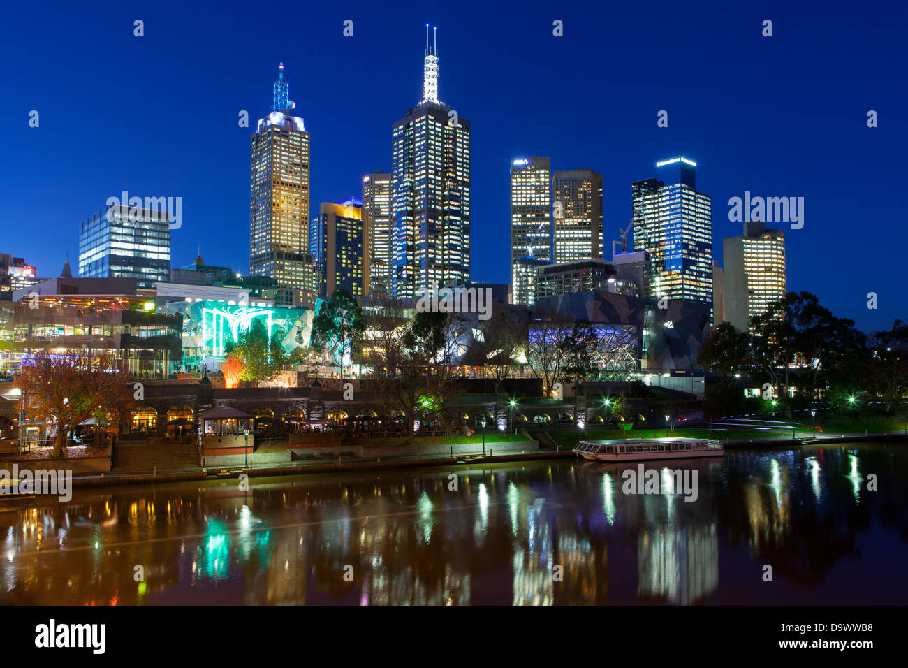 Melbourne skyline towards Fed Square, from Princes Bridge in Victoria, Australia - Stock Image