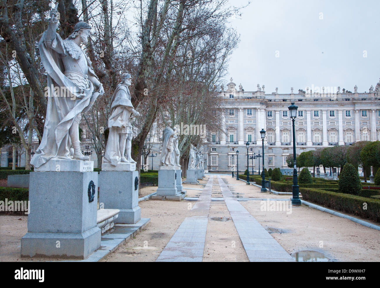 Madrid - The statues (19. cent.) depict Roman, Visigoth and Christian rulers from Plaza de Oriente in morning - Stock Image