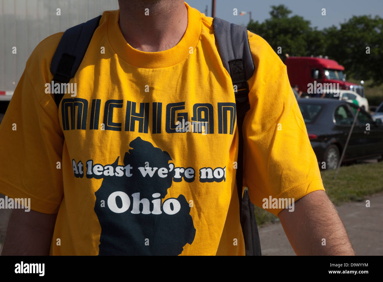 Detroit, Michigan - A man wears a t-shirt with the message: 'Michigan--at least we're not Ohio.' - Stock Image