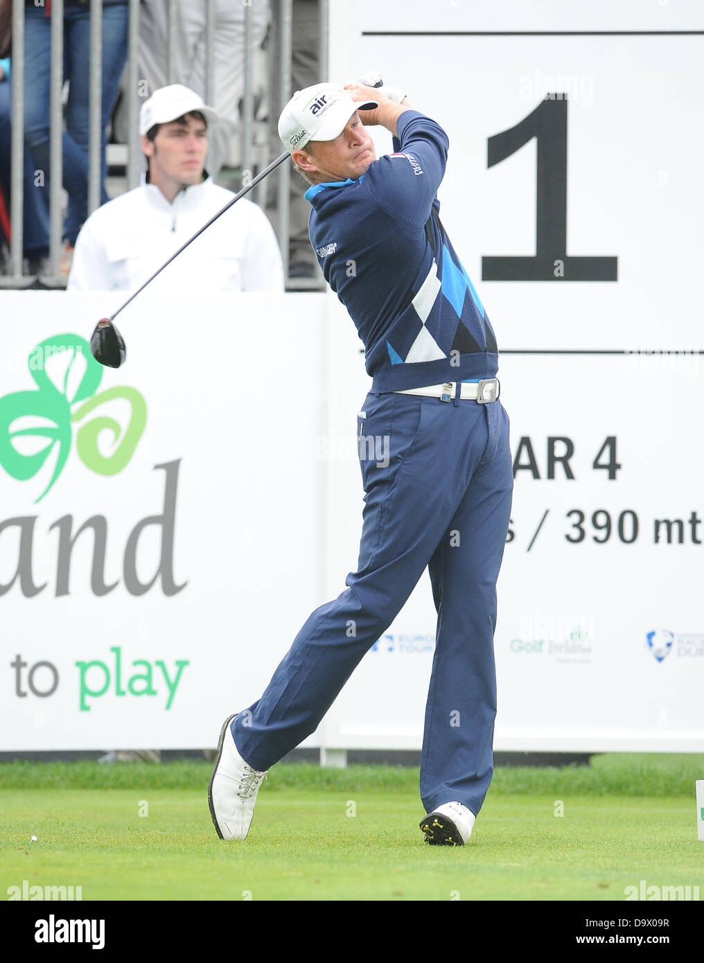 Maynooth, Ireland. 27th June 2013. Jamie Donaldson drives from the first tee during the first round of the Irish - Stock Image