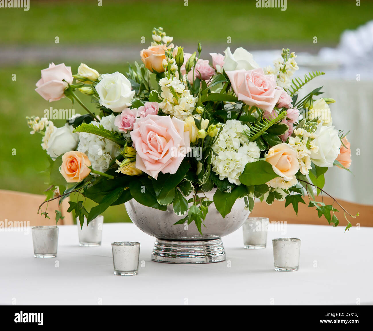 Flower arrangement in silver bowl with pink and white roses stock flower arrangement in silver bowl with pink and white roses mightylinksfo